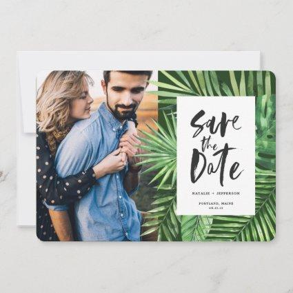 Tropical palm leaf and script foliage photo save the date