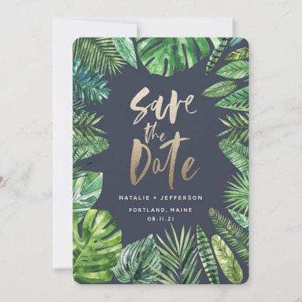 Tropical palm leaf foliage and gold script save the date